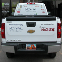 Vehicle Graphics for Royal Wholesale. Window perf in the back windows. Cut vinyl lettering/logo along the back and sides